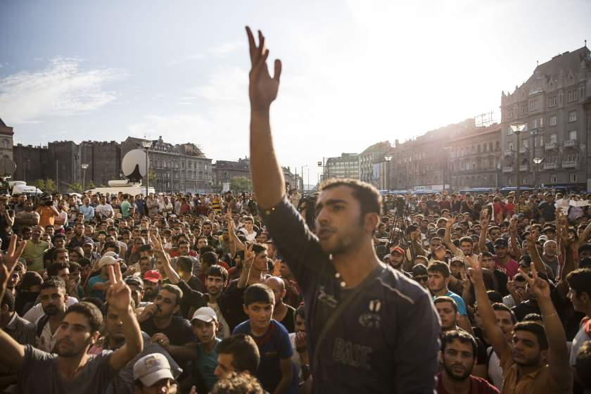 BUDAPEST, HUNGARY - SEPTEMBER 02 : Migrants protest outside Keleti station which remains closed to them in central Budapest on September 2, 2015 in Budapest, Hungary. Hundreds of migrants protest in front of Budapest's Keleti Railway Terminus for a second straight day on September 2, 2015 demanding to be let onto trains bound for Germany from a station that has been currently closed to them. (Photo by Arpad Kurucz/Anadolu Agency/Getty Images)